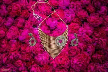 Bridal necklace and earrings with floral backdrop