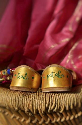 Cute bridal juttis with pataka written