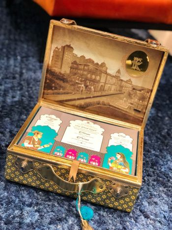 Photo of Suitcase style wedding invite box