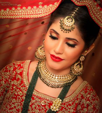 Pretty bride in red and gold