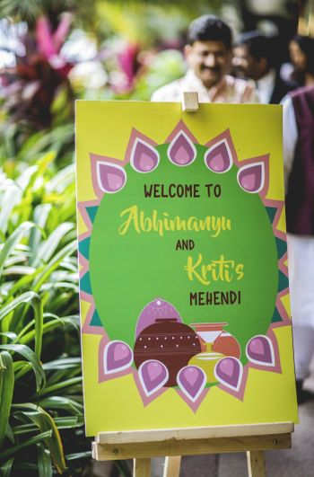 Mehendi entrance decor with printed board