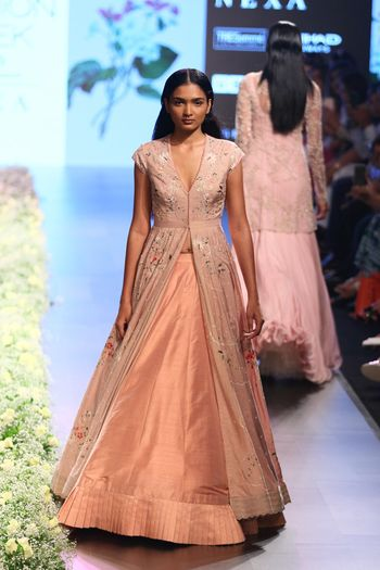 Photo of Peach lehenga with a floral printed jacket