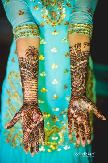 Unique bridal mehendi with ode to groom written