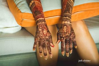 Mehendi with portraits of bride and groom on back of hands