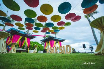 Hanging umbrellas with giant wedding hashtag