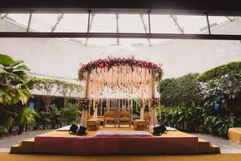 Mandap decor idea with floral dome and hanging strings