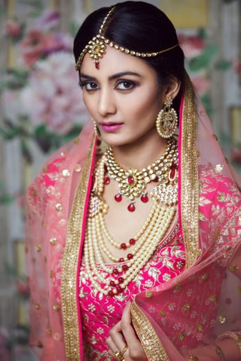 Pink bridal makeup with heavy contouring