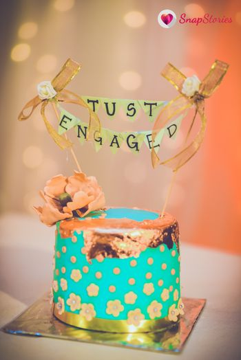 Just engaged cake topper on turquoise cake