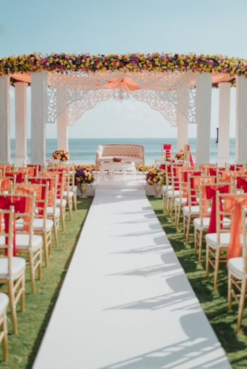 Photo of Beachside summer wedding mandap in white and peach