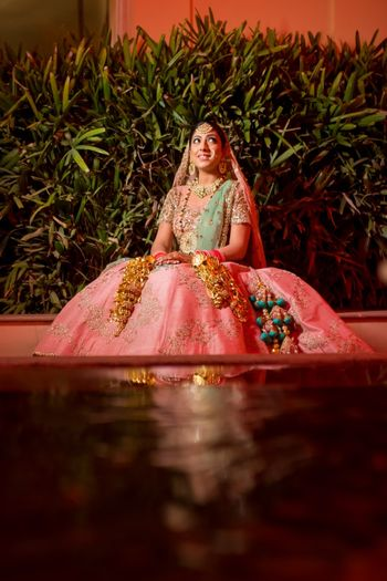 Light pink and green lehenga with contrasting tassels