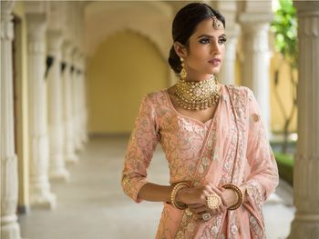 Light pink lehenga with pop of blue