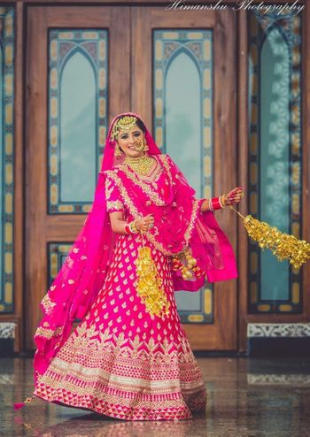 Bride in bright pink lehenga with kaleere