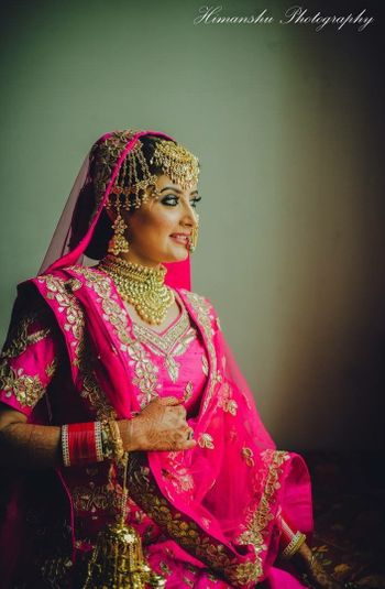 Bridal portrait with bold jewellery and pink lehenga