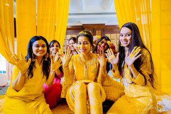 Bride with bridesmaids on haldi