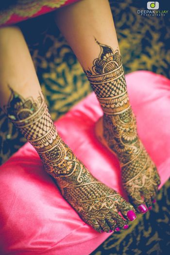 Bridal mehendi on feet with pink manicure
