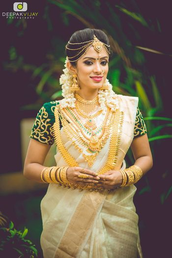 Traditional South Indian bride with layered jewellery