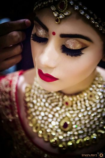 Bride with bold brows and red lips