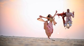Photo of Crazy couple jumping shot after wedding