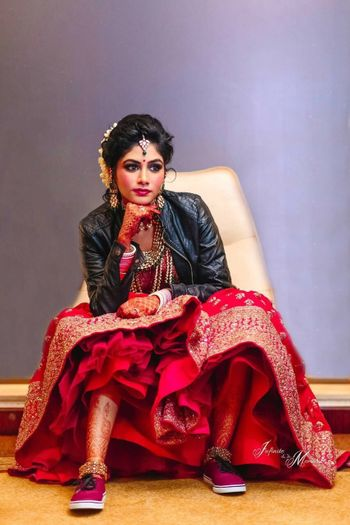 Modern bride with lehenga and leather jacket and sneakers