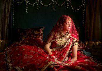 Bridal portrait in red with dupatta as veil