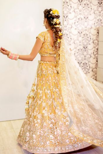 Mehendi hairdo with yellow lehenga