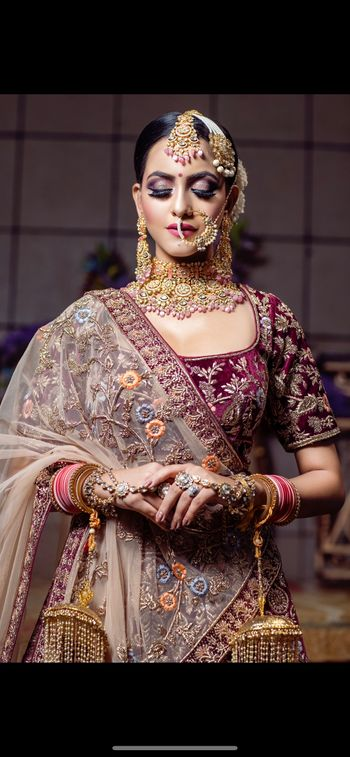 Bridal look with heavy jewellery.