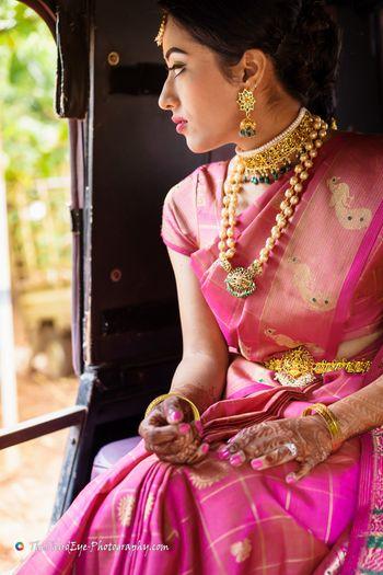 Pink kanjivaram saree with choker and layered necklace