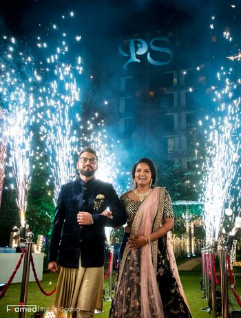 Couple entering on engagement with cold pyros