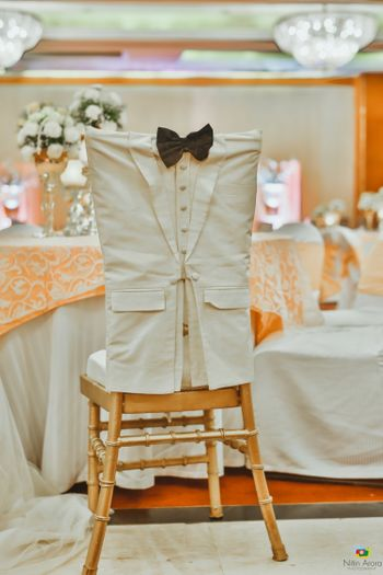 Groom chair with bow tie and suit