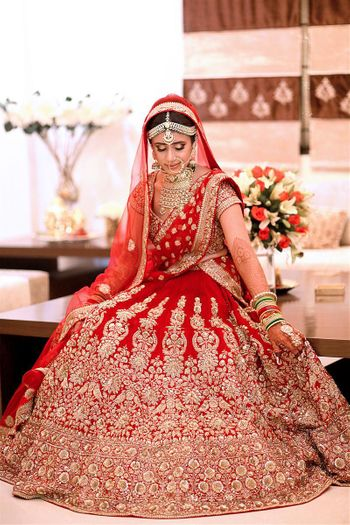 Red and gold flared out bridal lehenga portrait