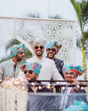 Groomsmen in matching floral safas