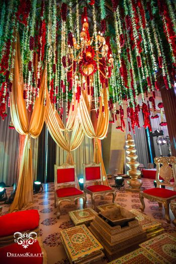 Mandap with hanging strings and drapes