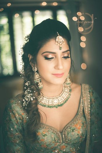 Pretty mehendi look with soft gold makeup