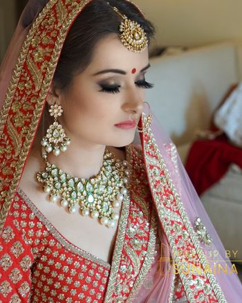 Bridal portrait in red with contrasting jewellery