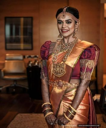 Gold kanjivaram bride with temple jewellery and unique blouse