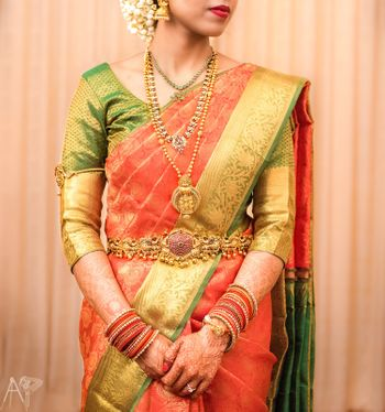 South Indian bridal jewellery with orange and green saree