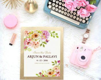 Floral invite with typewriter and polaroid