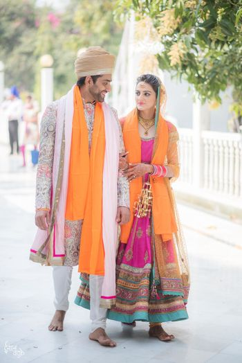 Sikh couple in coordinated outfits morning wedding