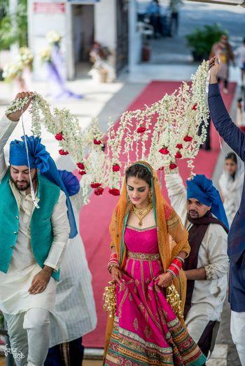 Bride entering wearing pink Anarkali