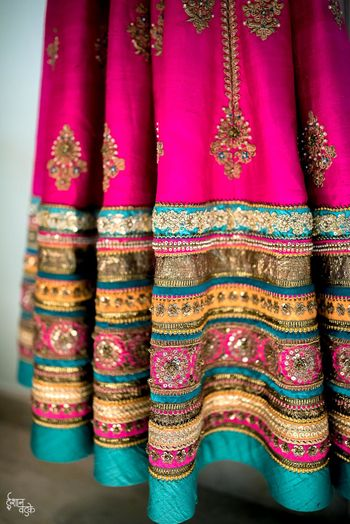 Bright pink and turquoise lehenga with broad border