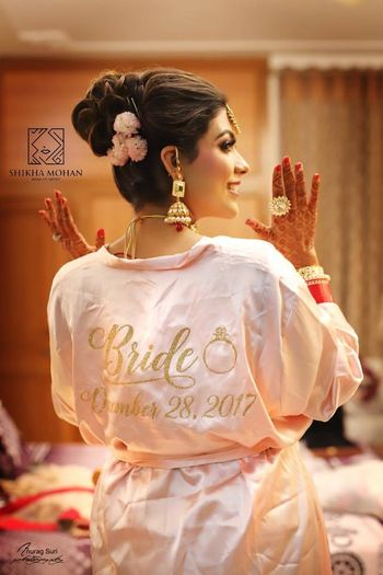 Bride getting ready shot idea with customised robe with wedding date