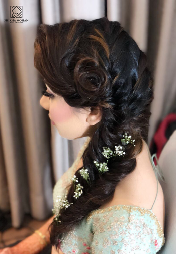 Intricate bridal braid for a mehendi or engagement function