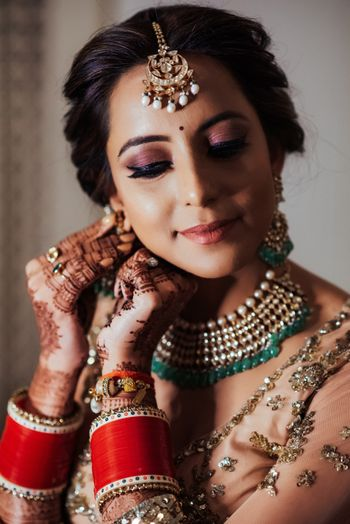 Candid shot of a bride wearing her earrings.