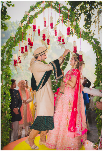 Floral mandap decor with hanging flowers
