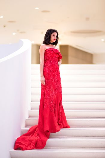 red cocktail gown with trail