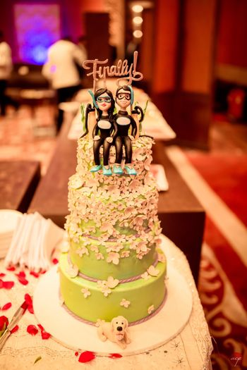 Wedding cake with diving cake topper