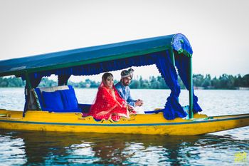 Photo of Bride and groom entering on a shikara