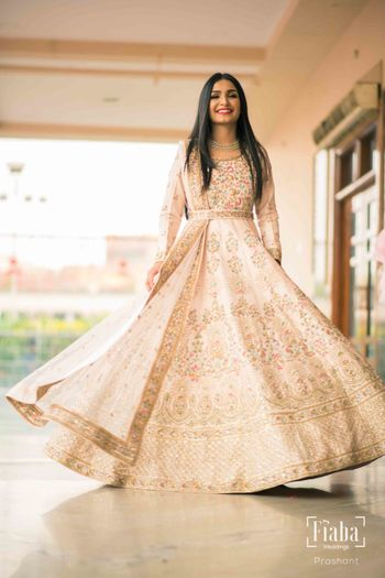 Floor length white Anarkali with belt for engagement