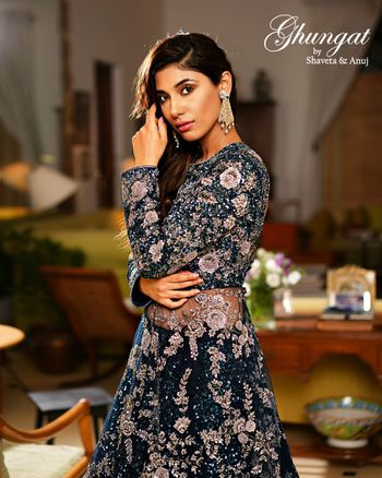Teal blue outfit with silver rose motifs