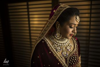 Shy bridal portrait with pretty jewellery
